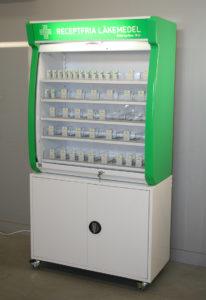 Läkemedelsställ för receptfria läkemedel med bottenskåp